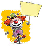 Clown on Unicycle Holding Placard Stock Photography