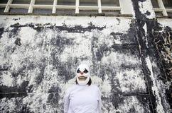 Clown urban street. Crazy clown mask halloween costume and fear stock photos