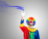 Clown using a blue pencil Royalty Free Stock Photo