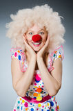 Clown with white wig against Stock Photography