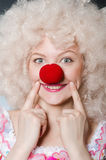 Clown with white wig against Royalty Free Stock Photo