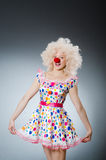 Clown with white wig against Stock Image