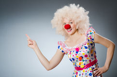 Clown with white wig against Stock Photo