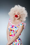 Clown with white wig against Stock Photos