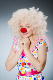 Clown with white wig against Royalty Free Stock Image