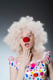 Clown with white wig against Stock Images