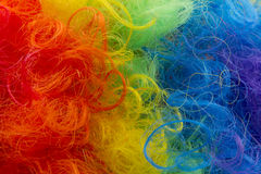 Clown wig background. Rainbow color clown wig curly abstract background Stock Photography