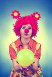 Clown woman with a ball vintage toned Stock Photos