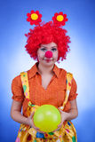 Clown woman character on blue background Royalty Free Stock Photos