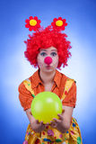 Clown woman character on blue background Royalty Free Stock Image