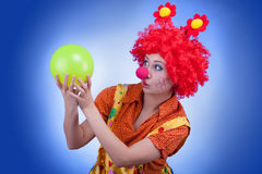 Clown woman character on blue background Stock Photo