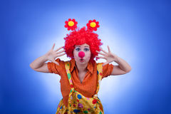 Clown woman character on blue background Stock Images