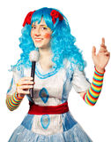 Clown woman wearing colorful dress singing Stock Photography