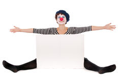 Clown woman and white billboard Stock Photography