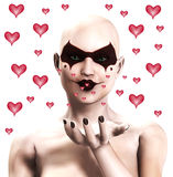 Clown Women Sending Out Hearts. A bald female clown, blowing out kiss love hearts Stock Images