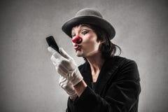 Clown zelf die in de spiegel kijken royalty-vrije stock foto's