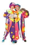 Clowne mit Kaninchen und Waschbären Stockfotos