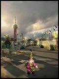 Clowner som omkring kör Royaltyfri Foto