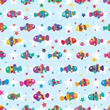 Clownfish colorful star symmetry seamless pattern. This illustration is design clownfish colorful with star symmetry and free in seamless pattern Royalty Free Stock Photos
