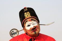 Clownframsida i yangkodansshow, under den kinesiska våren Festi Arkivbilder