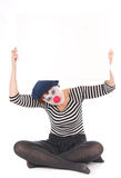 Clownfrauen-Holdinganschlagtafel stockfotos
