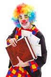 Clownholdingaktenkoffer mit Geld Lizenzfreies Stockfoto
