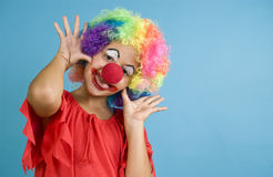 Clowning Around. A child dressed in a clown costume playing the part royalty free stock photos