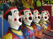 Clowning Around... A row of clown faces at a funfair Stock Photography