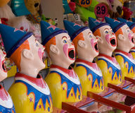 Clowns. Brightly colored sideshow clowns at a fair Royalty Free Stock Images