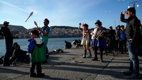 Clowns arrange representation for refugees. Mytilini, Lesvos. Clowns arrange representation for refugees to support them. Lesvos, Greece. November 2015 stock video footage