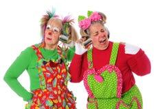 Clowns ayant des problèmes avec la transmission Photographie stock libre de droits