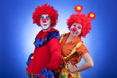Clowns on blue background studio shooting Stock Image