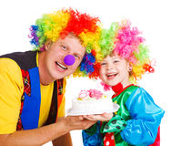 Clowns with a cake Royalty Free Stock Photos