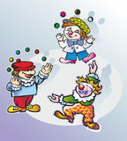 Clowns in the circus. Three people artists clowns juggling balls balls in the circus Stock Images