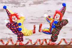 Clowns with colorful costumes at carnival party Royalty Free Stock Image