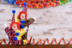 Clowns with colorful costumes at carnival party Stock Photos