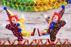 Clowns with colorful costumes at carnival party Stock Photo