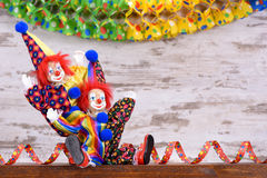 Clowns with colorful costumes at carnival party Royalty Free Stock Images