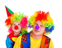 Clowns in colorful wigs. Isolated Stock Photography