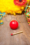 Clowns costume. Utensils of a clowns costume laying on a wooden board Stock Photography