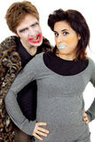 Clowns. Couple young people dressed as clowns, isolated Royalty Free Stock Photography