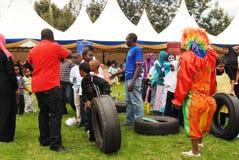 Clowns entertainment  in Nairobi Kenya. Clownshow, men women and  Children having fun in Nairobi Kenya during organized events such as social gatherings Royalty Free Stock Image