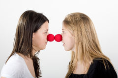 Clowns face to face. Clowns with big red nose for laughing Royalty Free Stock Photo
