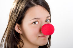 Clowns face to face. Brown hair Clown with big red nose Stock Image