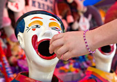 Clowns at fete or fair. Taking a chance by putting the ball in the clowns mouth to see where it lands Stock Photography