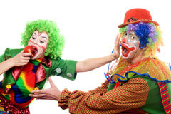 Clowns are fighting for an apple Royalty Free Stock Image