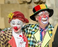 Clowns at Grimaldi Service, Hackney. LONDON, UK - FEBRUARY 7, 2016:  Two clowns sharing a joke ahead of the annual church service in memory of Joseph Grimaldi stock images