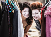 Clowns Peeking from Clothes Rack Royalty Free Stock Photo