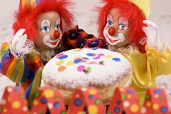 Clowns with red hairs and sweet donut Stock Photography