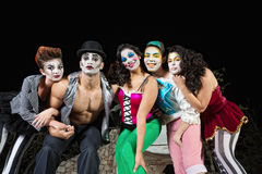 Clowns on Stage. Group of character clowns posing on stage stock images